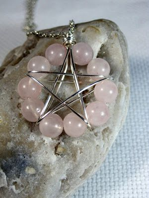 Wire wrapped pentacle in rose quartz.