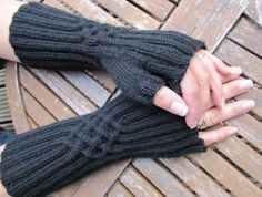 Photo of Wrist warmers – cable-rib pattern …