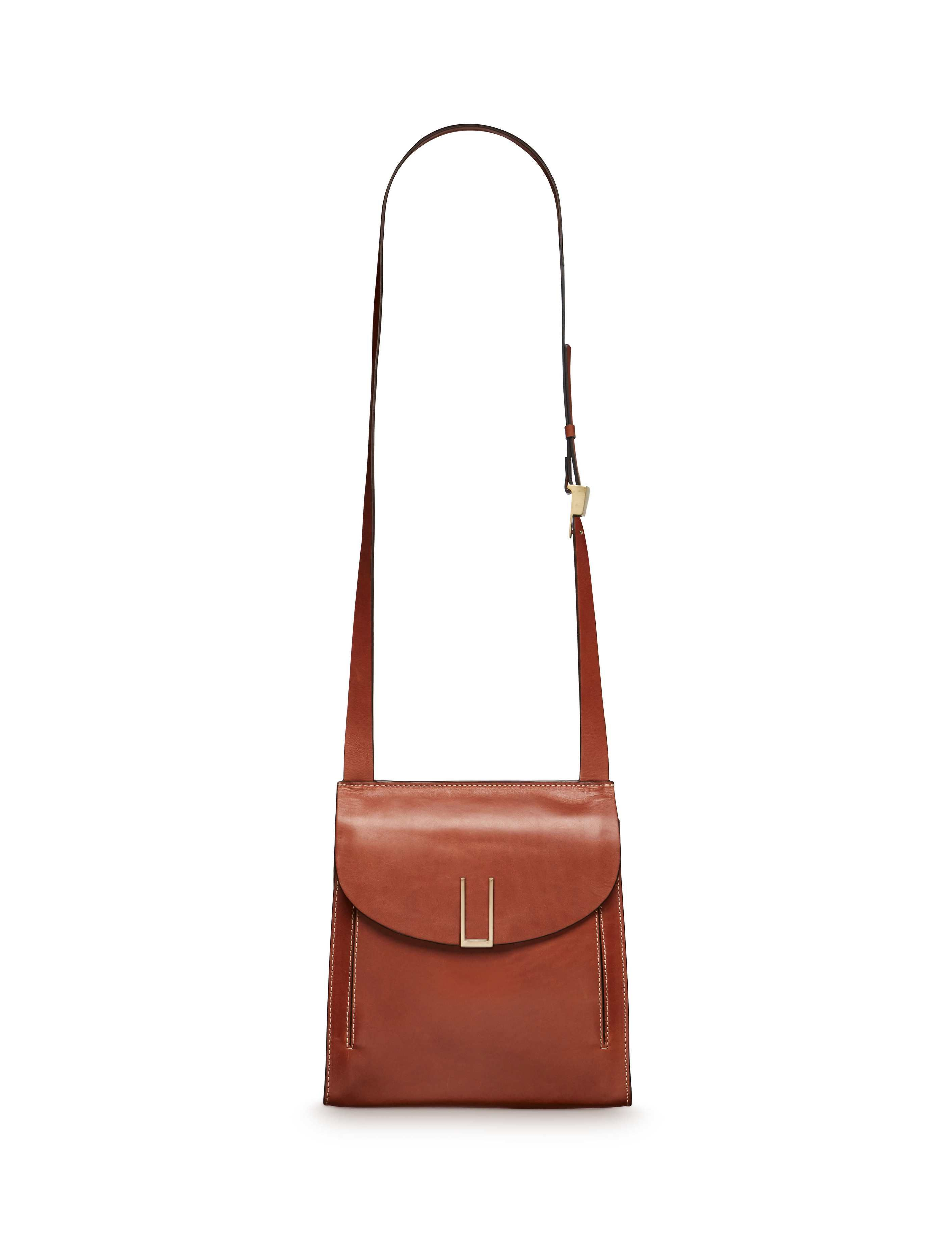 0254227e897 Women s crossbody bag in plain leather with U-shape buckle. Features  adjustable shoulder strap