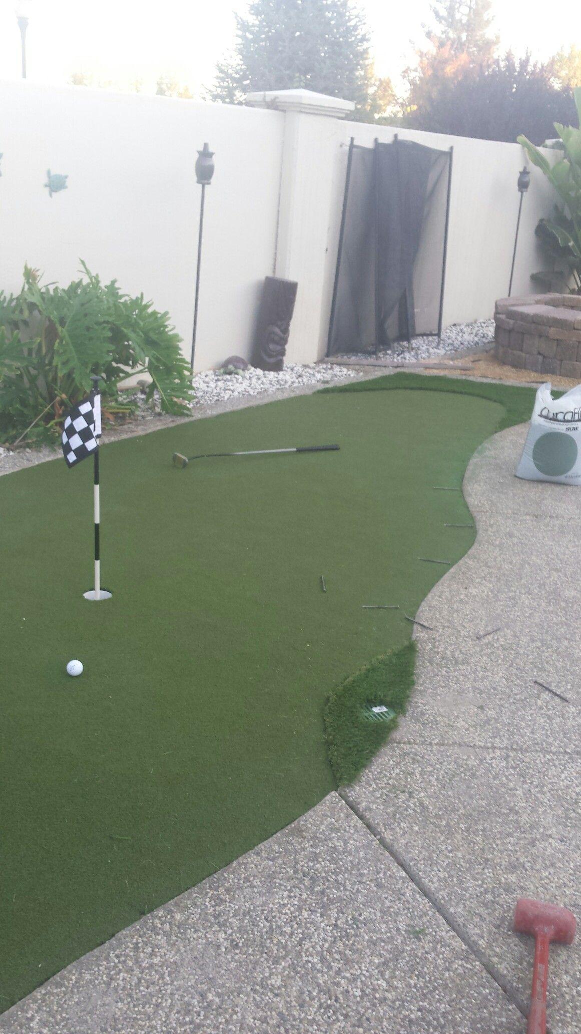 putting green around the pool backyard putting green