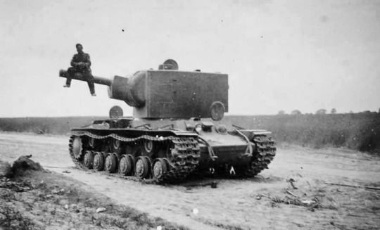 German Soldier Posing To Photo While Sitting On The Barell Of Kv 2