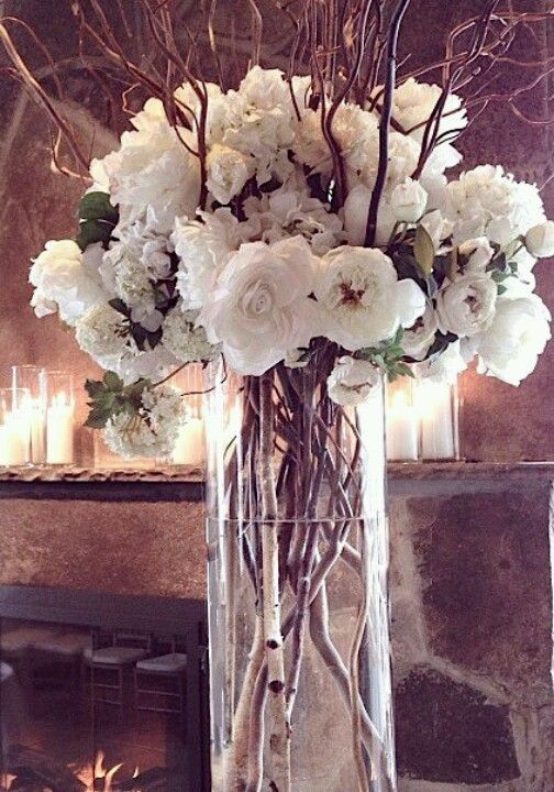 Stunning reception florals with branches and roses and hidrangeas