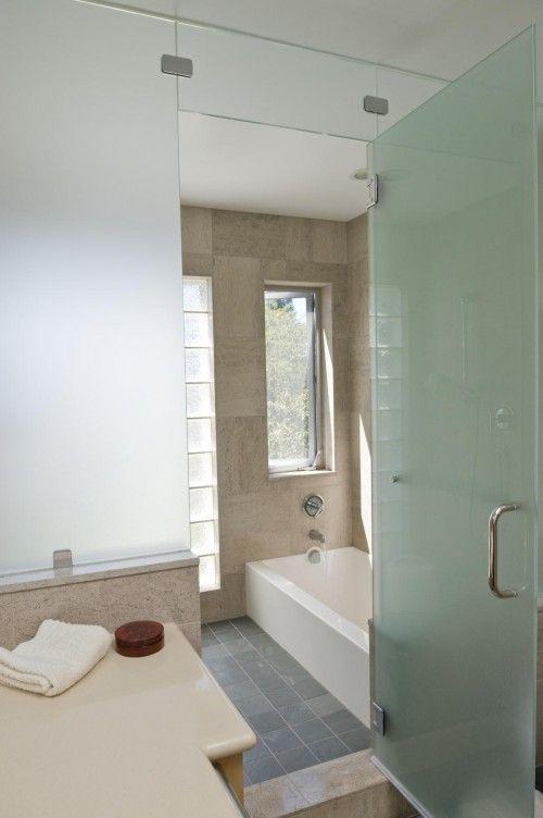 Kids Bathroom Has A Sunken Bathtub With Open Shower Opposite