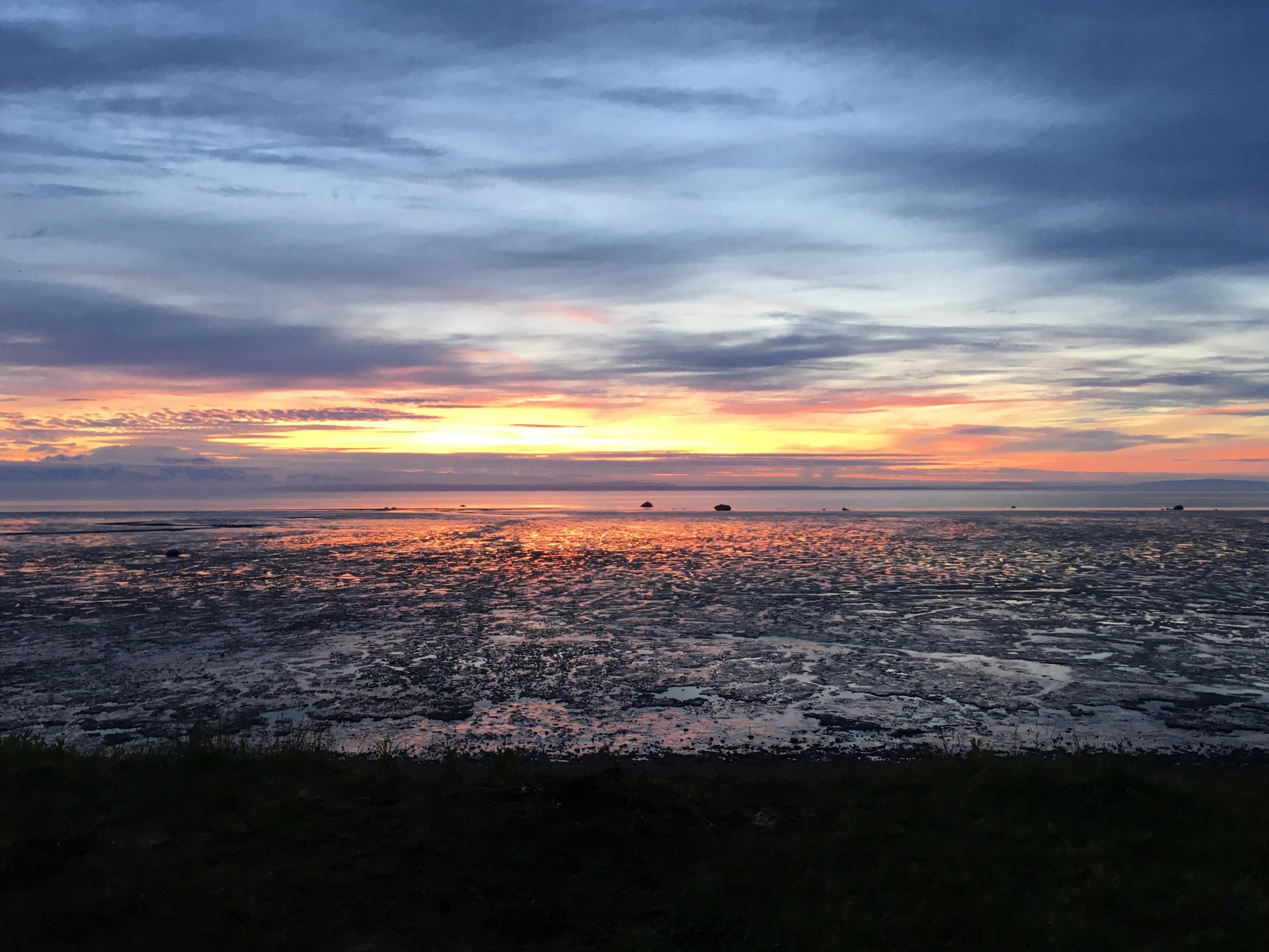 A glimpse of the sun setting over nikiski alaskas gorgeous mud flats