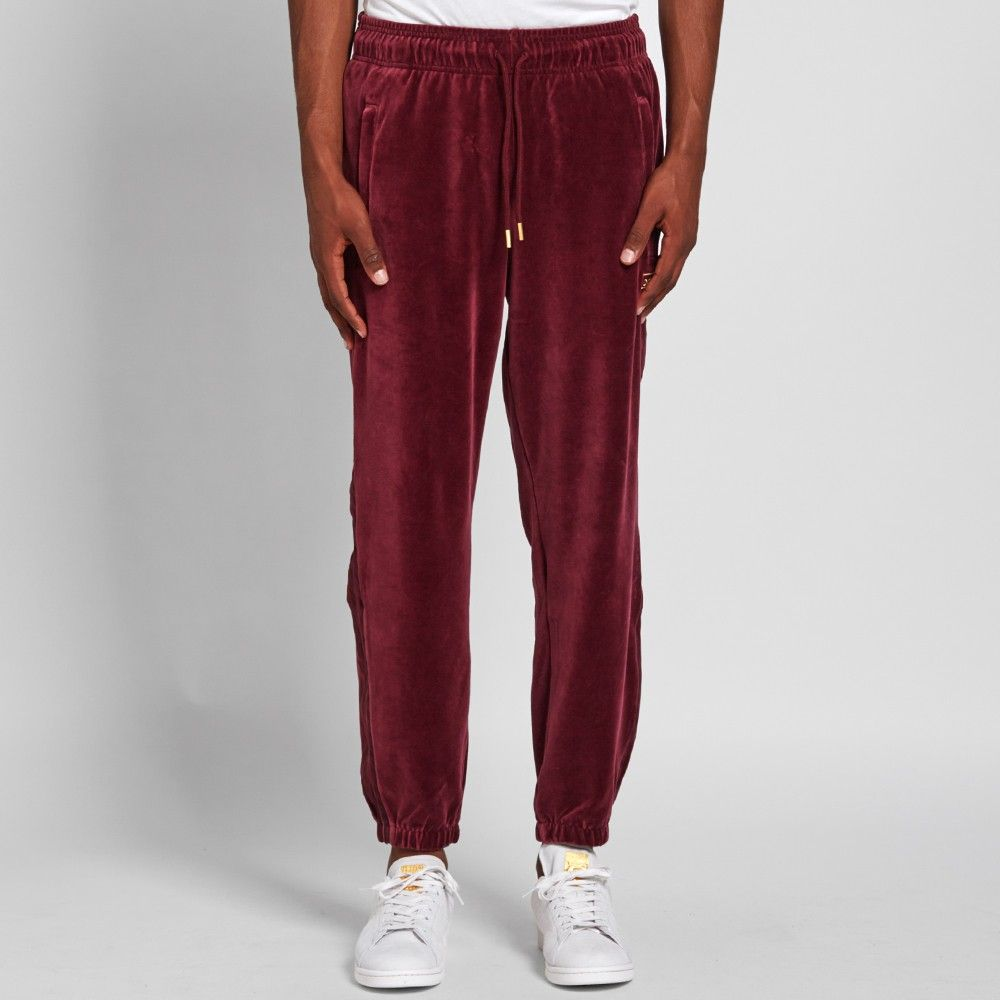 Complete the retro '70s vibe with adidas' velour sweat pant. The velvet-