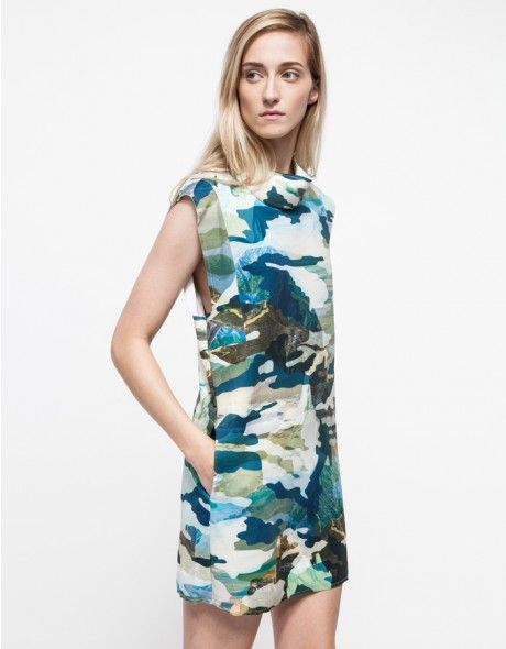 From Cameo, a lightweight neoprene dress in a camo pattern. Features a rounded neckline, boxy silhouette and exposed back zipper closure.   •Lightweight neoprene dress •Rounded neckline •Allover camo pattern •Exposed back zipper closure •9