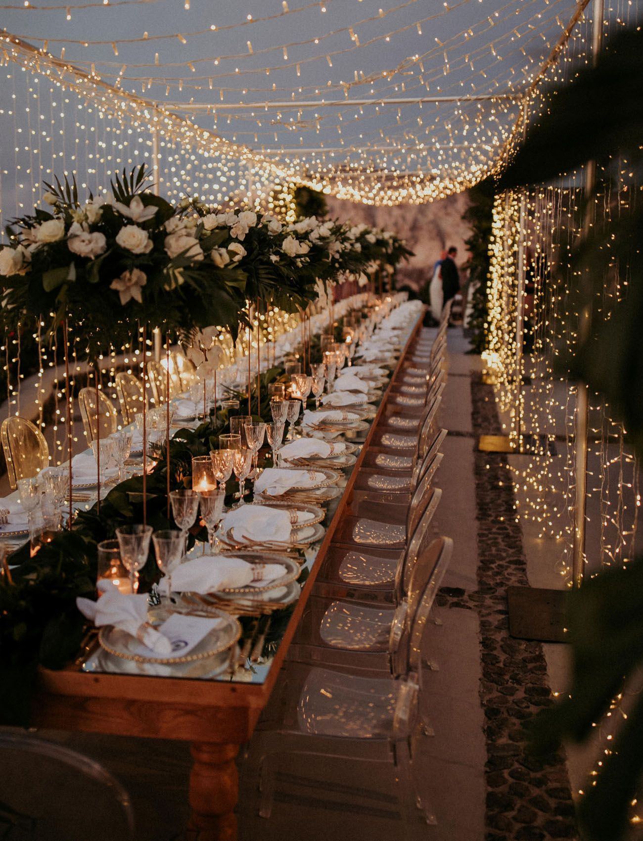 A Magical Santorini Wedding with Fairy Lights + Tropical Florals