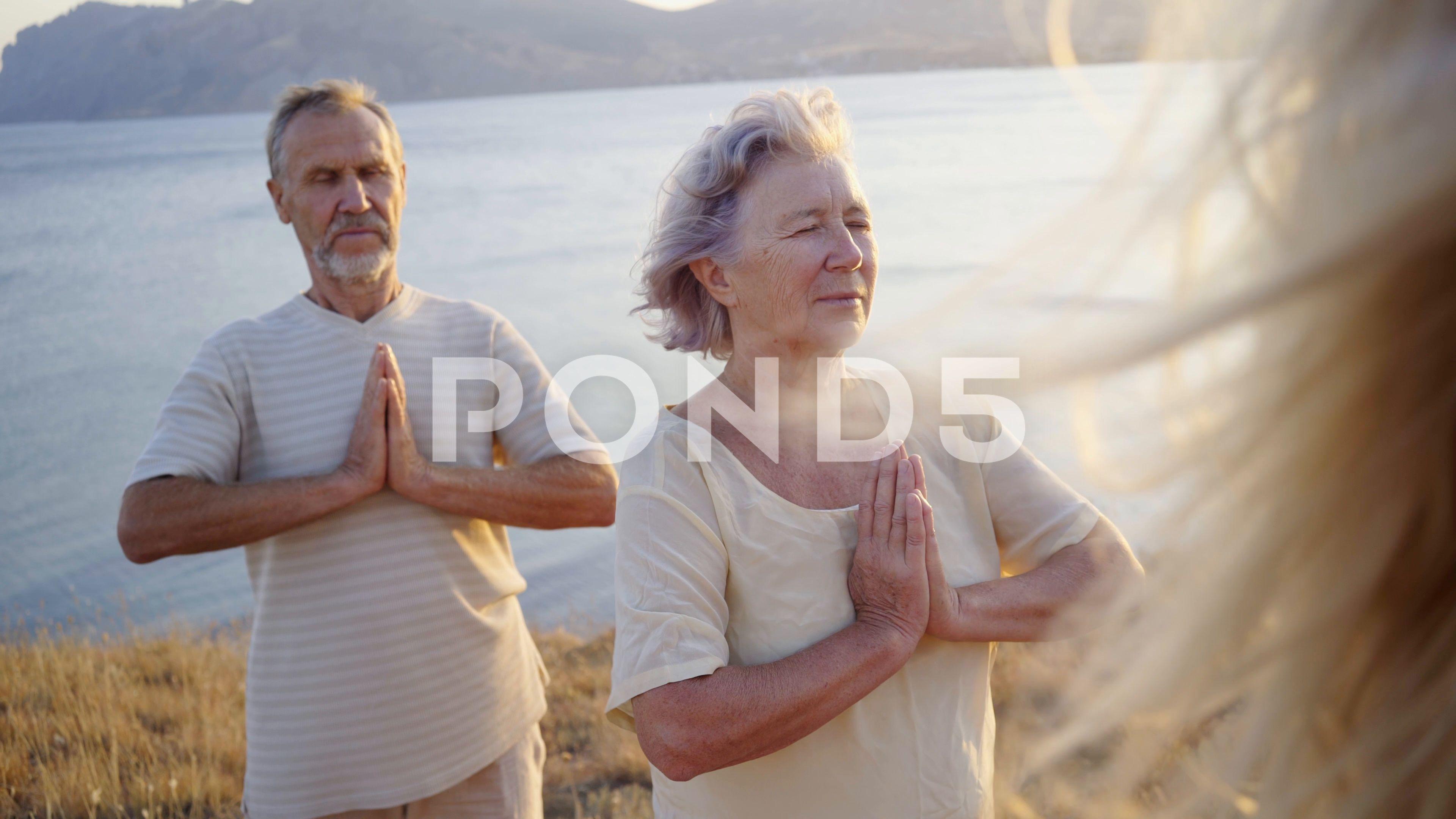 Group of senior people doing yoga at sunset peopleseniorGroupyoga