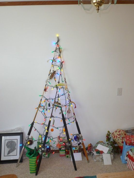 My Brother S Fishing Pole Christmas Tree With Picture Of His Dog