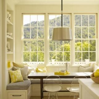 kitchen nook with a huge window.   Yellow, gray, and sunlight.
