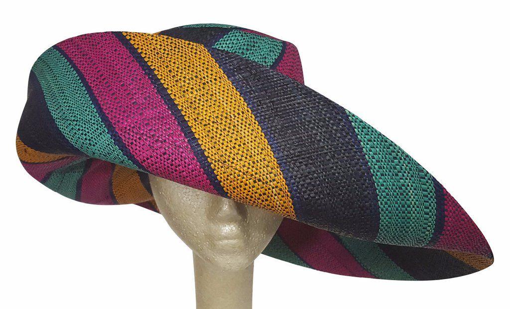 A hand made Madagascar raffia sun hat. This hat has great SPF/UPF sun protection. Perfect for cruises, beaches, Kentucky Derby, church, teas, or festivals.