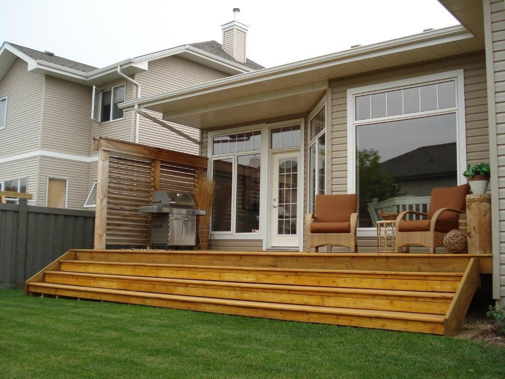 Deck and patio designs exterior deck and privacy wall in for Deck designs for small backyards