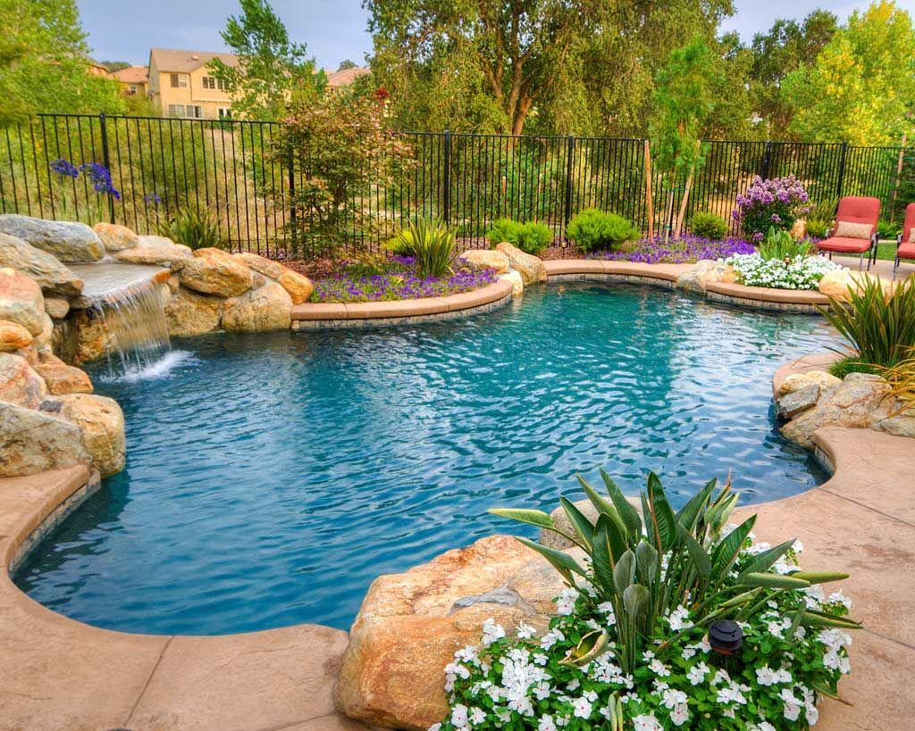 Freeform swimming pools freeform swimming pools are the perfect fit for your relaxing yard with Natural swimming pool builders