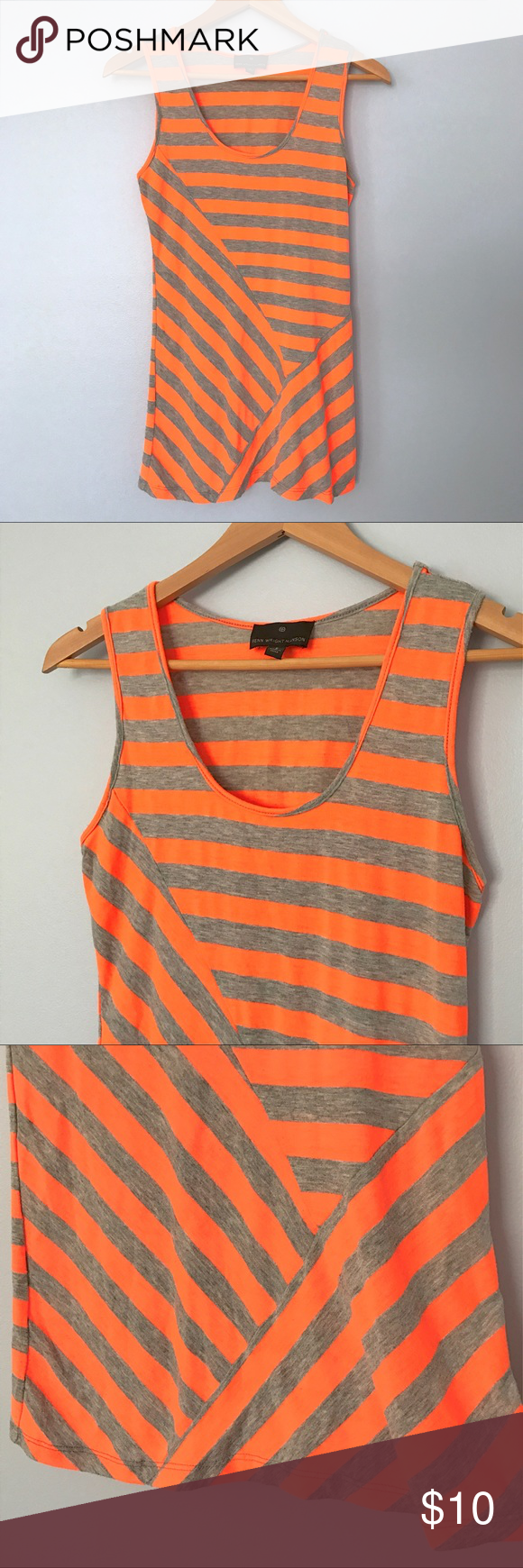 "Fenn Wright Manson Asymmetric Neon Tunic Tank Top Fenn Wright Manson neon striped long tank top.  Asymmetrical hem and seams.  Neon orange and heather gray stripes.  Gently used - no holes or stains, but there is a touch of wash wear.  47% rayon, 47% polyester, 6% spandex.  Approx. flat lay measurements: length 28"", width across underarms 15 1/2"". Fenn Wright Manson Tops Tank Tops"