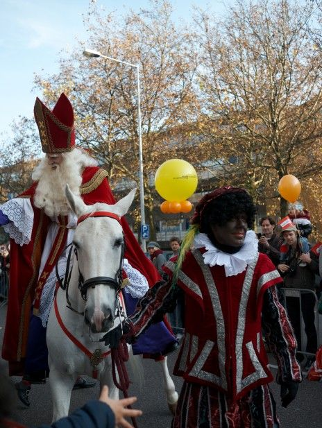 Ushered through Amsterdam by one of his loyal helpers-Zwarte Piet, Sinkerklaas rests atop his faithful steed-Amerigo, and surveys the throngs of jubilant Dutch children, all ecstatic he has finally arrived safely via steamer from his home in Spain with gifts in tow, merrily as it ever were. The season of Sinterklaas has begun...