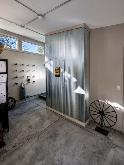 The Galvanized Metal Wraps Around The Corner Where A Bathroom Door Sheathed In Metal Blends Into The Wall Corrugated Wall Corrugated Metal Wall Entry Design