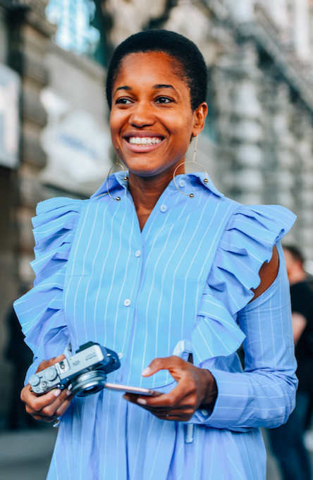 The best way to wear ruffles? With a big smile. tamu Mcpherson photographed by Tommy Ton at MFW #styledotTon
