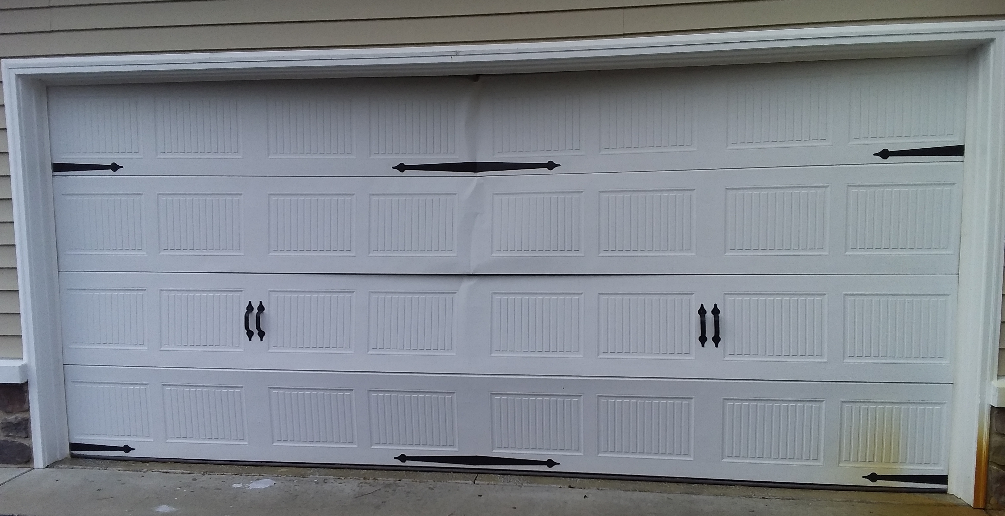 16x7 Model 5251 Stamped Carriage Style Garage Door Installed By The Richmond Store Teamappledoor In 2020 Carriage Style Garage Doors Garage Doors Door Installation