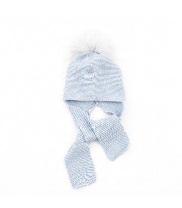 38e6573bd5538 Gorro de punto azul con pompón de pelo natural para bebé