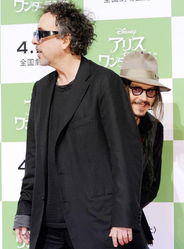 Johnny Depp sneaks up on his friend Tim Burton
