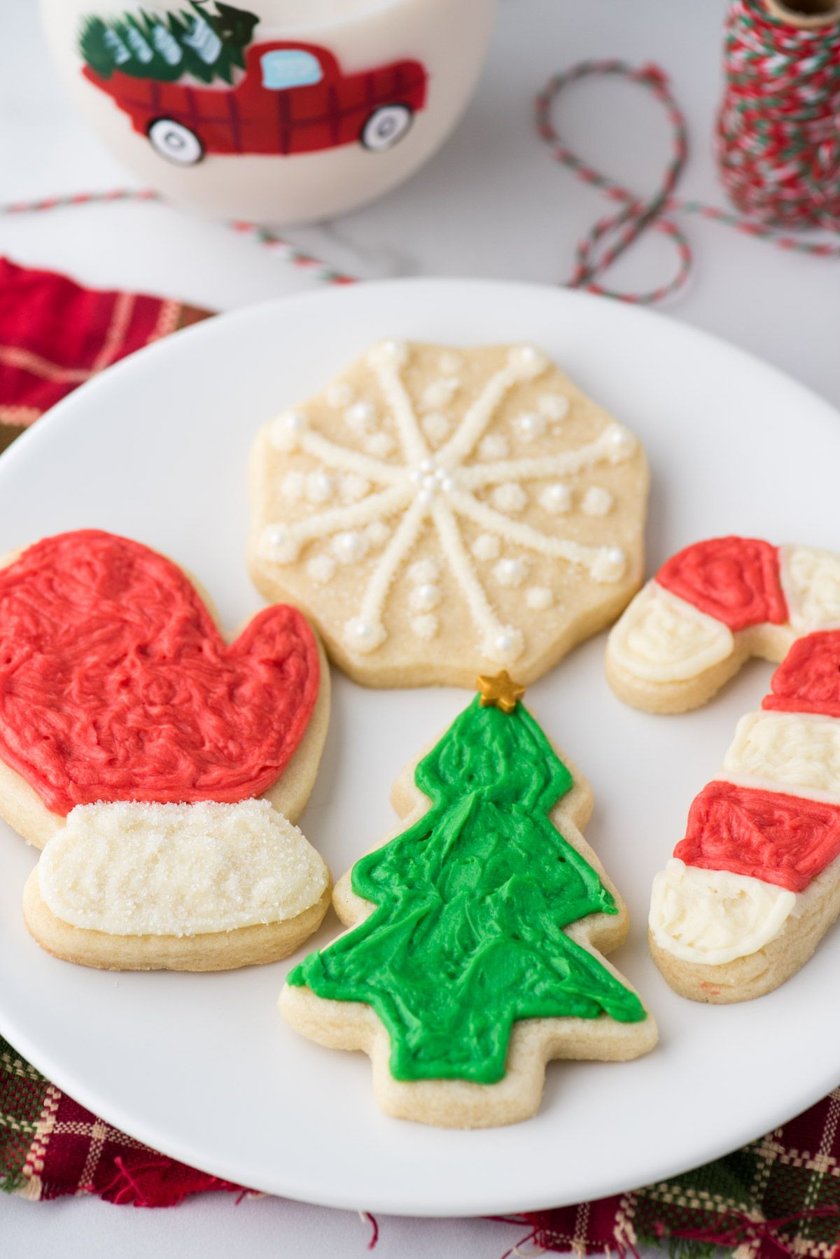 Cut out sugar cookies are perfect for the holidays! This recipe has ALL the options - a no chill option, a gluten free option, plus buttercream and royal icing recipes! The recipe is easy to follow with step by step pictures and a video tutorial! #cutoutsugarcookies #cutoutcookies #christmassugarcookies #easyroyalicingrecipe