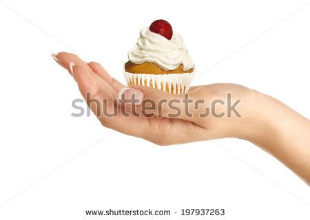 Closeup of Beautiful female hand give a rich cupcake on white