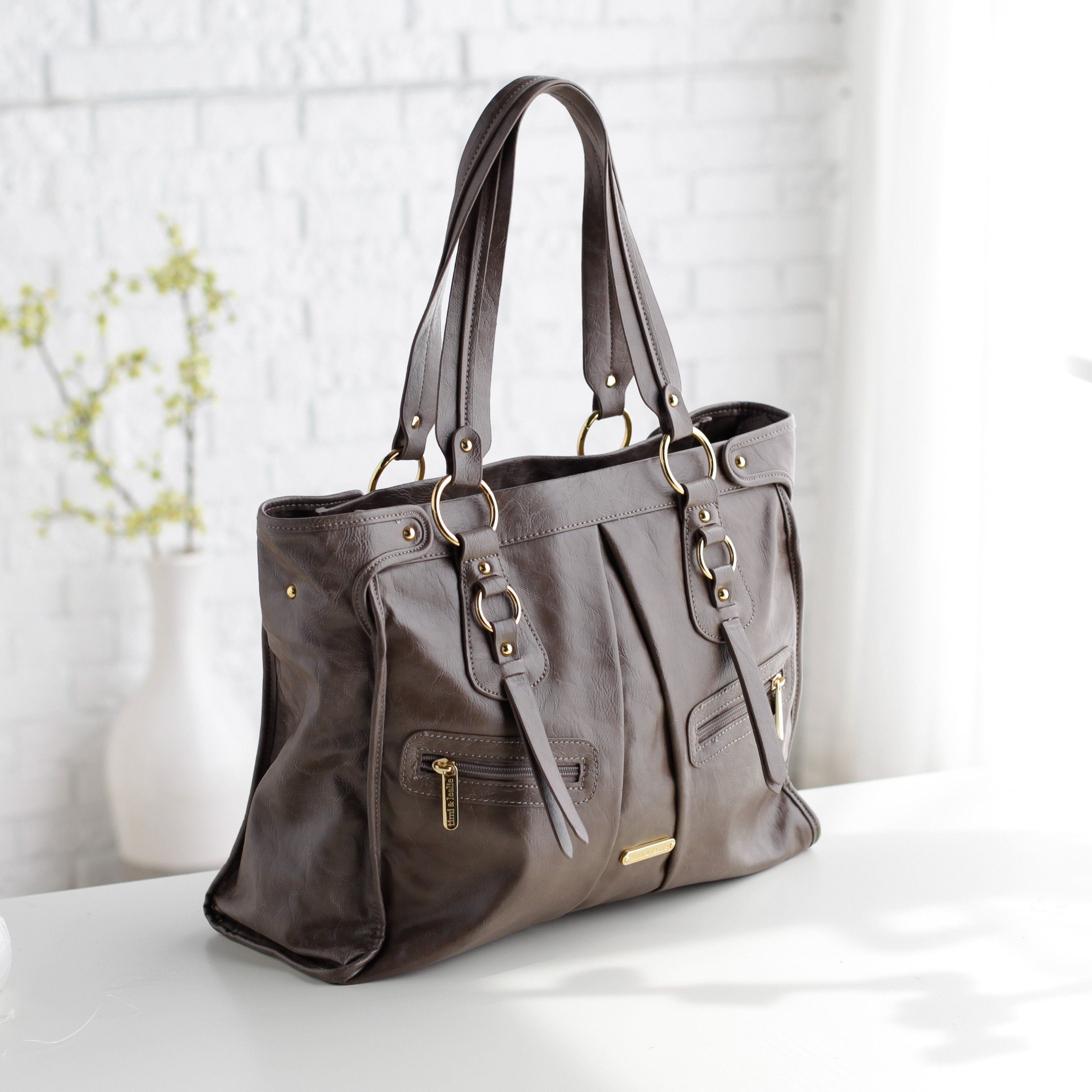 Timi And Leslie Dawn Convertible Diaper Bag Taupe We Live In An Age Of The Statement Handbag But Last You Want To Make Is A Formula