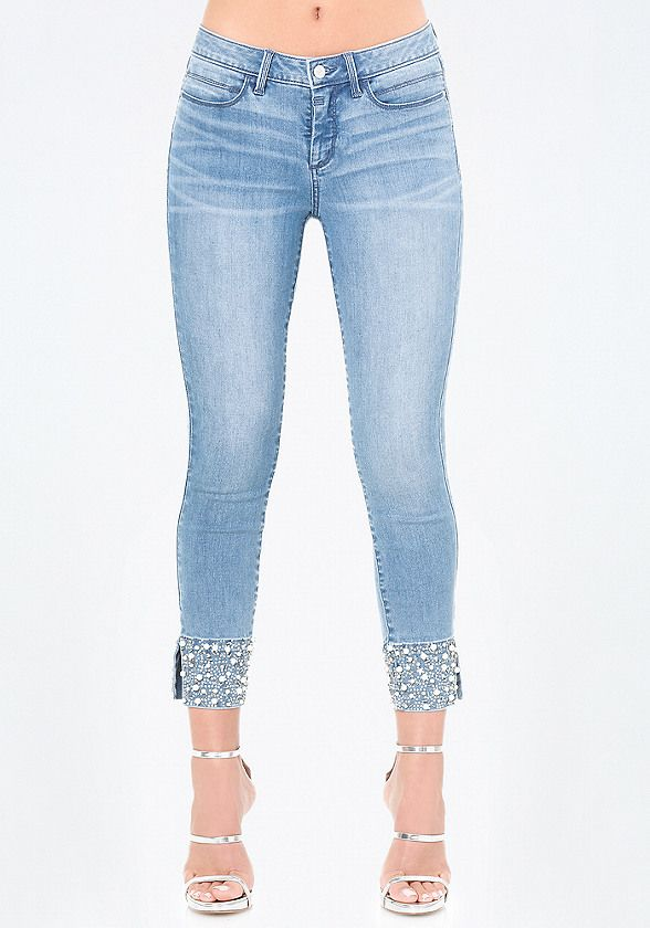989a5d365 ... Sassy cropped jeans with blinged-out cuffs covered in lustrous  crystals, beads and faux pearls. 5-pocket styling. Front zip fly closure.  Back bebe logo.