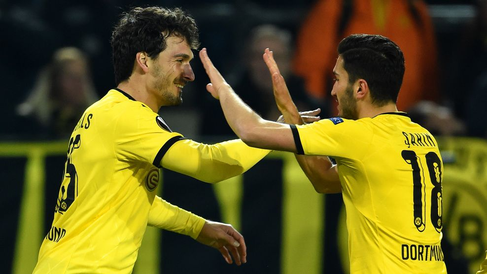 Mats Hummels (L) of Dortmund celebrates with Nuri Şahin after scoring their first goal during their UEFA Europa League quarter-final first leg against Liverpool