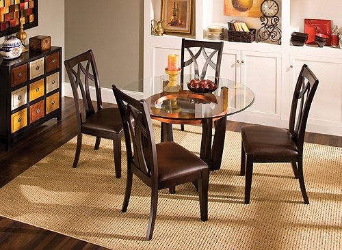 """This Elation 5-pc. 48"""" glass dining set combines clean lines with a striking cappuccino finish and sleek glass. The dining table's shape is graceful, and it shows off the natural beauty of wood and glass. A decorative copper leaf ring under the tabletop adds a flash of style and color."""