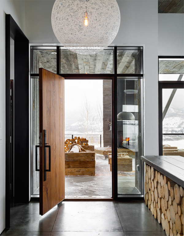 Modern House With Foyer : Modern mountain house tour entryway with log storage