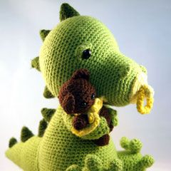 Found at Amigurumipatterns.net, this may be a present for my darling wife who has a tattoo of a dragon holding a teddy bear