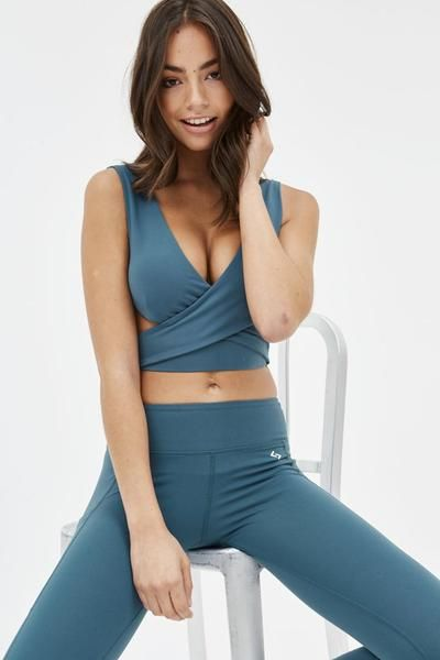 25c0294b77 The wrap around bra is double-lined for extra support and has removable  padding. The stylish design means you can wear it for your workout or under  a ...