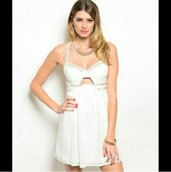 Gorgeous Open Back Dress Brand new. Great details. Sleeveless short dress. Beautiful open back. Features a sweetheart neckline with formed bust and silver bead trim. Empire cute pleated waist. Dresses Mini