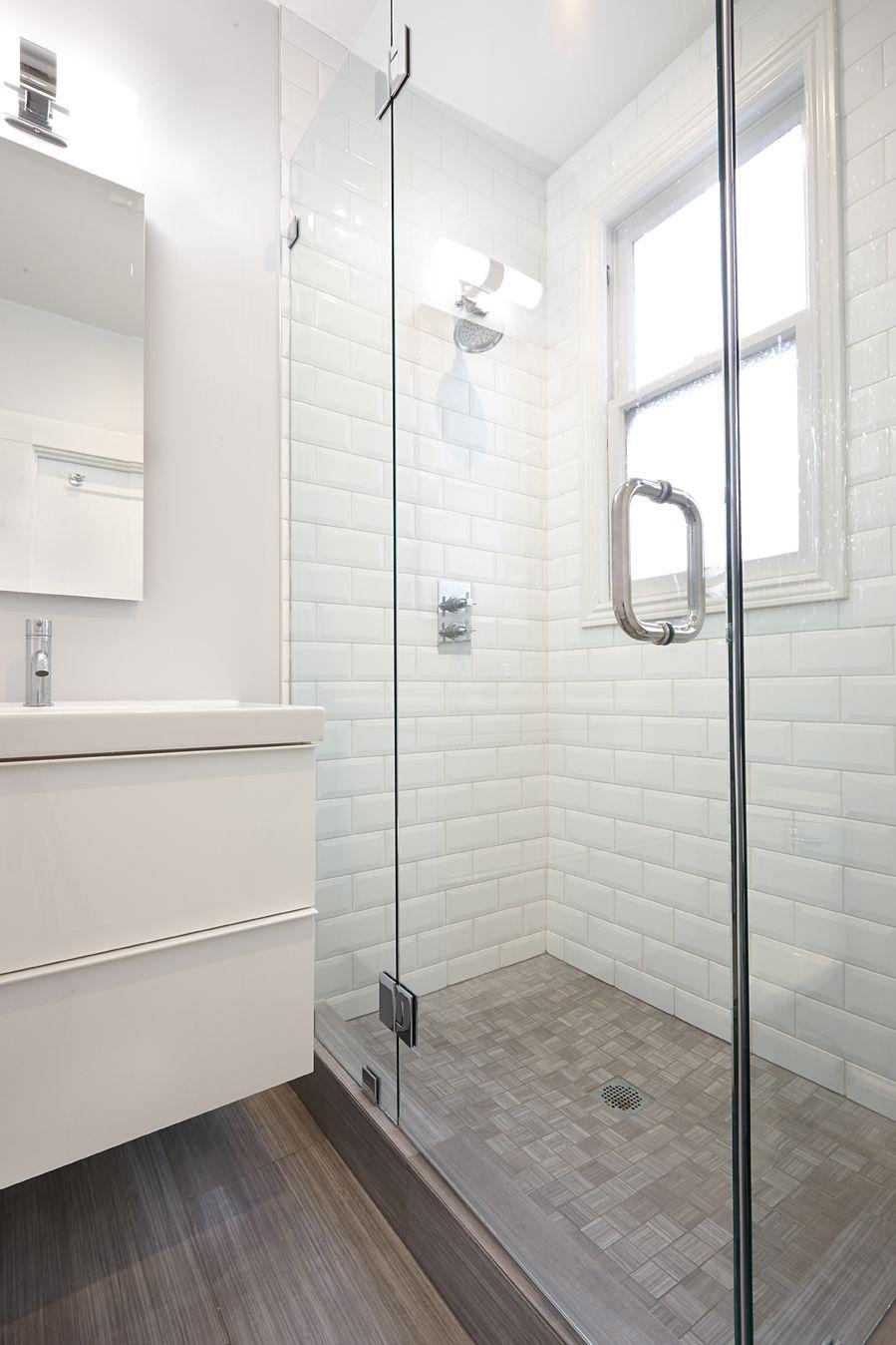 Beveled white subway tile with grey floor Nerland SF