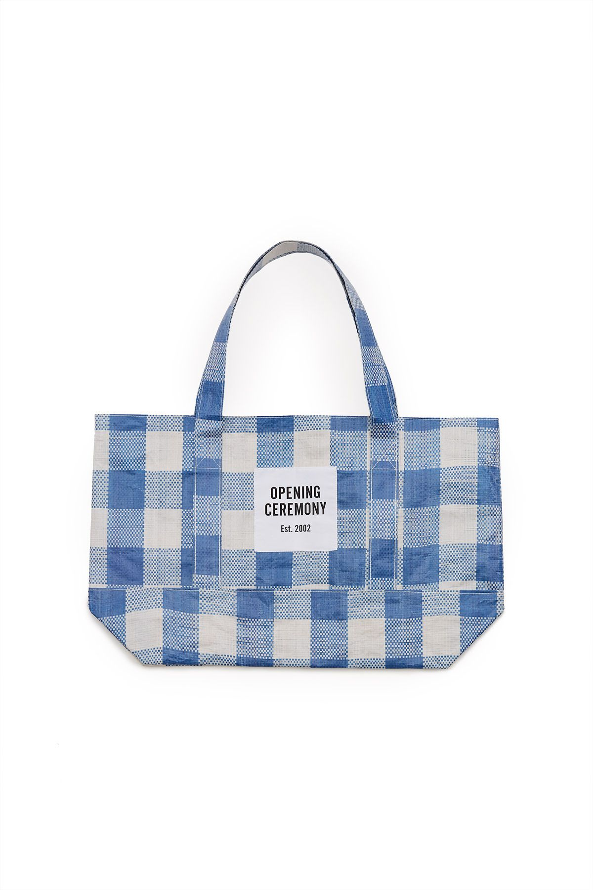 5a96fe7765b1 Opening Ceremony, Gingham Medium Tote OC's signature tote bags are cut from  sturdy but lightweight gingham-printed tarp material. Available in black,  blue, ...