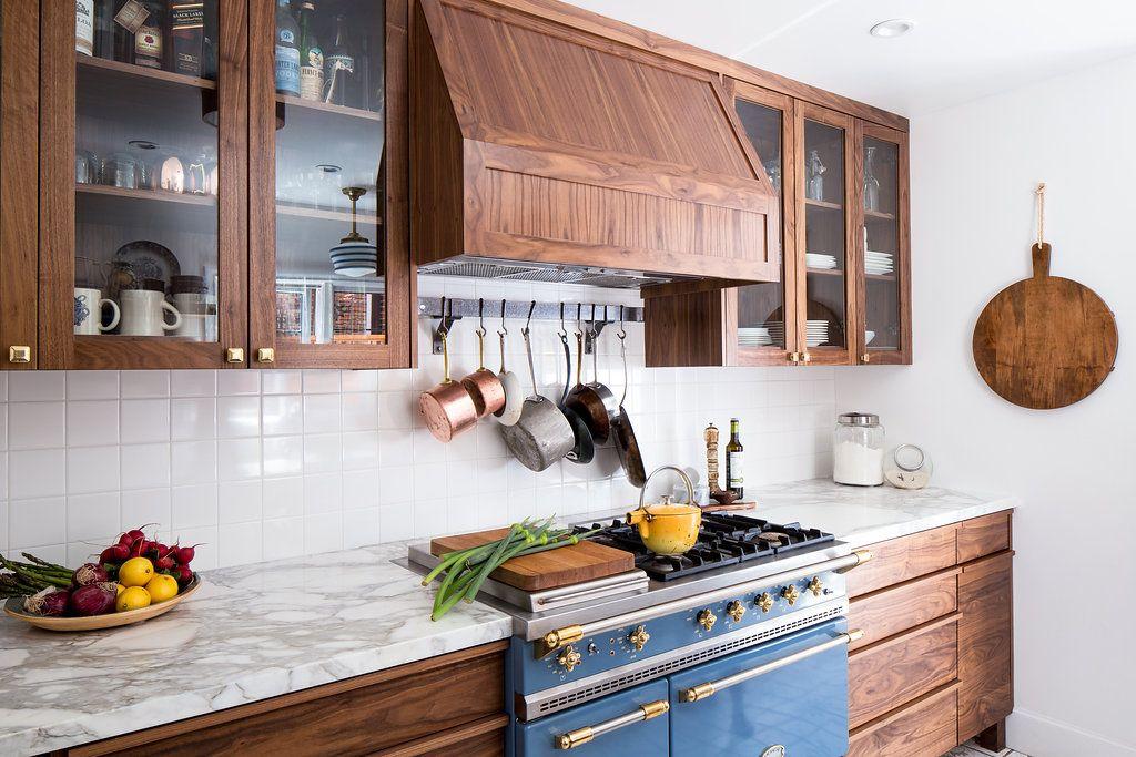Custom walnut cabinetry, calacatta marble countertops, Lacanche ...