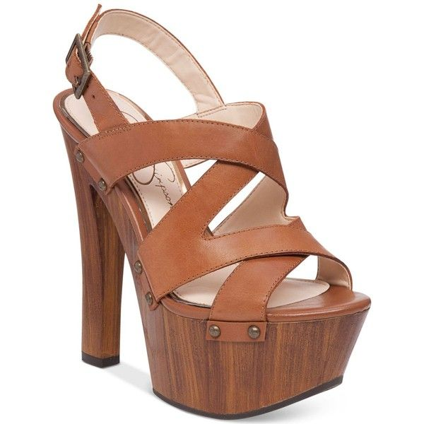 Jessica Simpson Damelo Strappy Wood-Heel Platform Sandals ($77) ❤ liked on Polyvore featuring shoes, sandals, burnt umber, wood heel sandals, studded t-strap sandal, strappy shoes, wooden heel platform sandals and strappy platform sandals