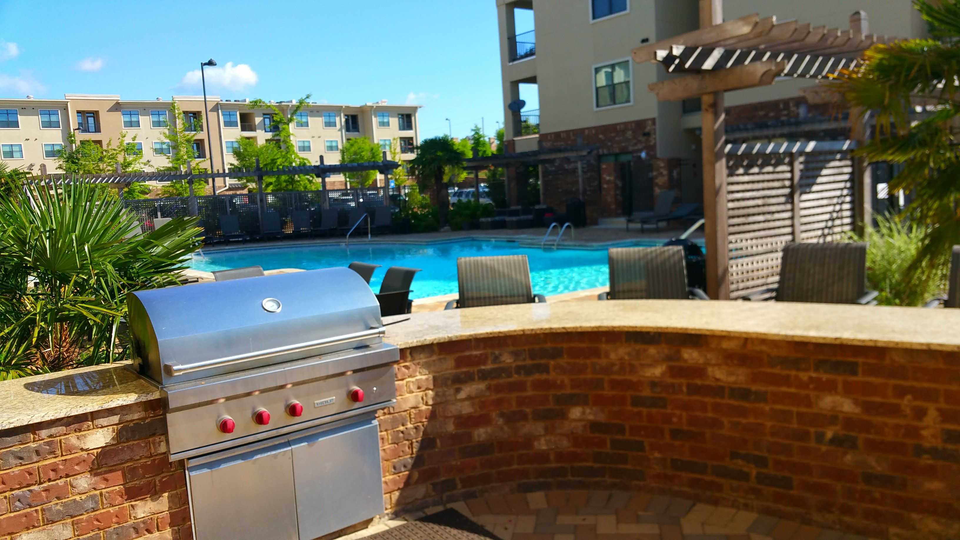 Relax at our salt water pool.  Enjoy a BBQ while you are there! Terraces at Suwanee Gateway Apartment Homes