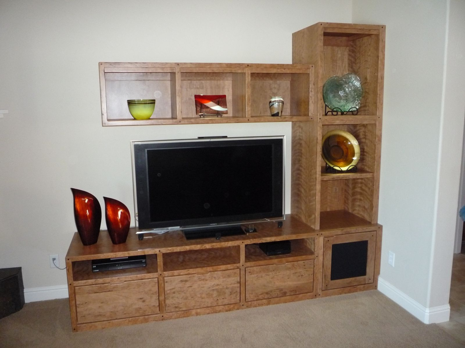 Custom made custom cherry entertainment center for the home