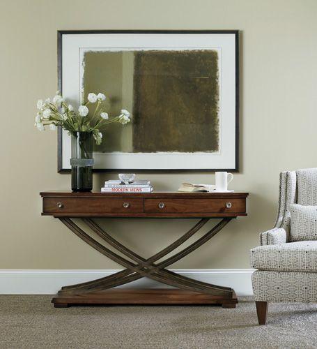 The Palisade cross-base sofa/console table combining walnut veneers & metal
