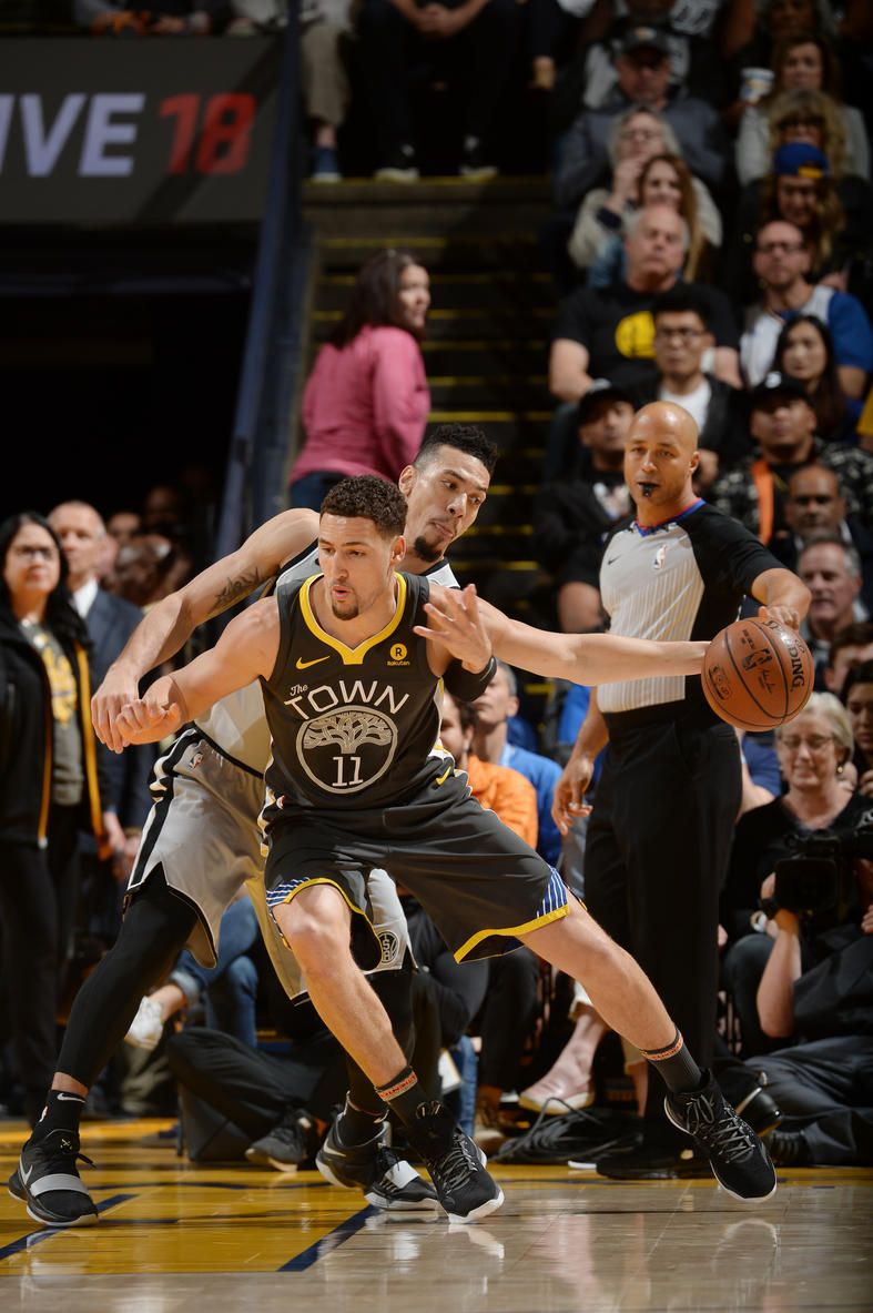 oakland-ca-february-10-klay-thompson-11-of-the-golden-state-warriors-handles-the-ball-against-the-san-antonio-spurs-on-february-10-2018-at-oracle