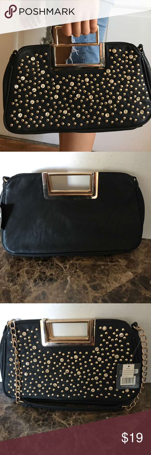 Uncategorized Leather Like Material black clutch with gold accents boutique studs this fancy is a leather like material handles that fold in when not being