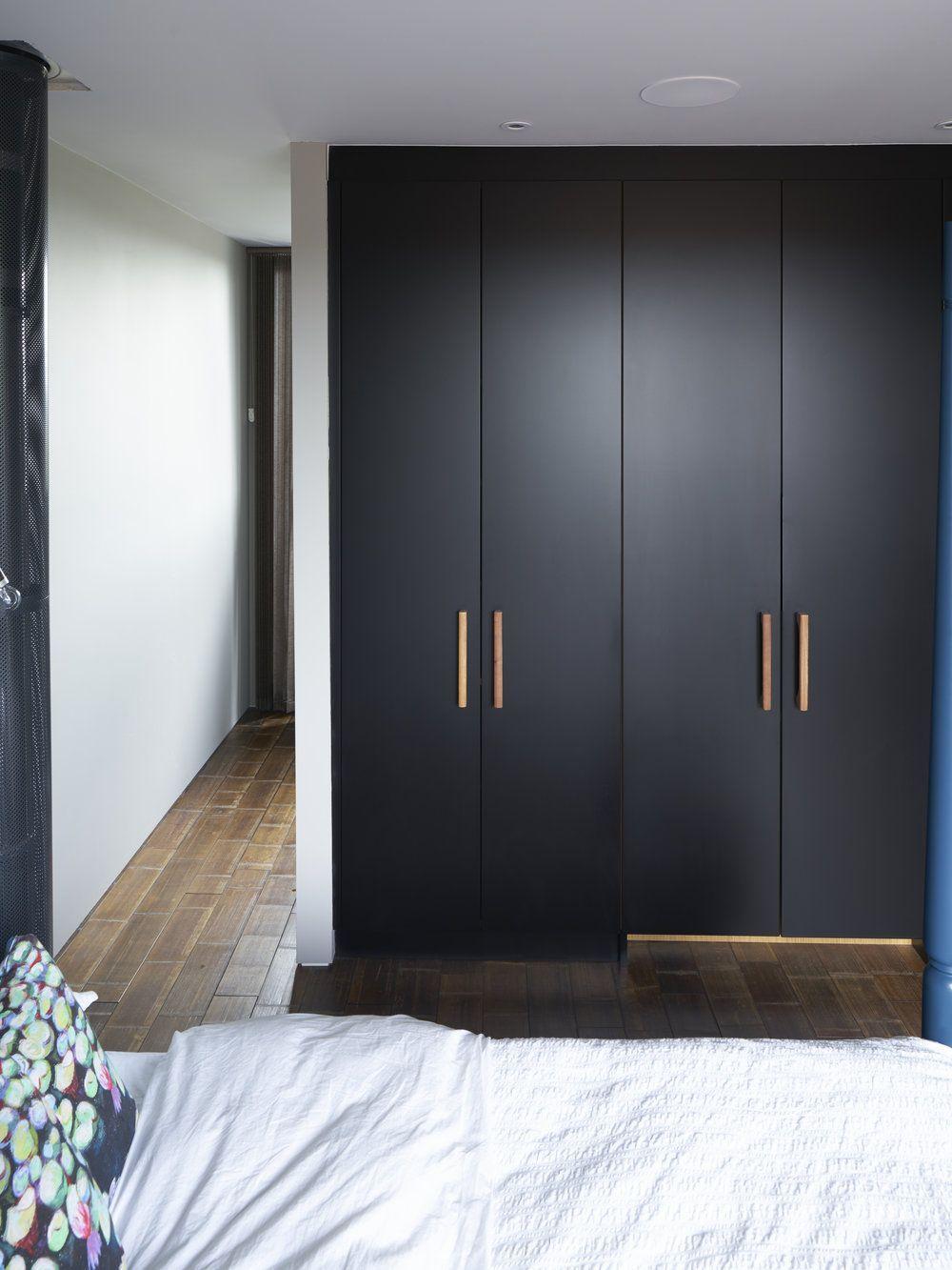 Black Matt Lacquer Wardrobes with bespoke oak handles ...