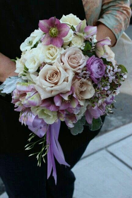 Beautiful Wedding Bouquet With Roses Ranunculus Hellebores Wax Flower Freesia Dusty Miller In A Purple Pe Purple Flower Bouquet Purple Flowers Wax Flowers