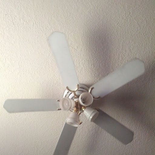 An Old Rickety Ceiling Fan Running At