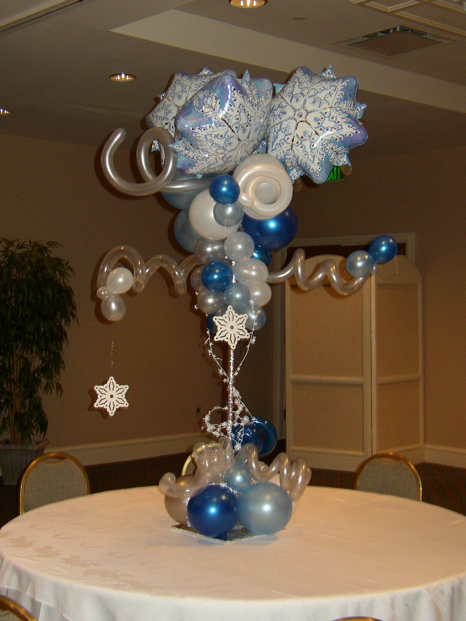 Snowflake winter wonderland theme centerpieces bar