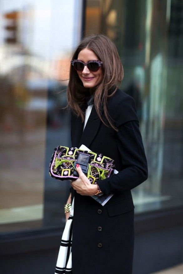 the incredibly chic Olivia Palermo wearing bold cat-eye sunglasses and a printed clutch in NYC
