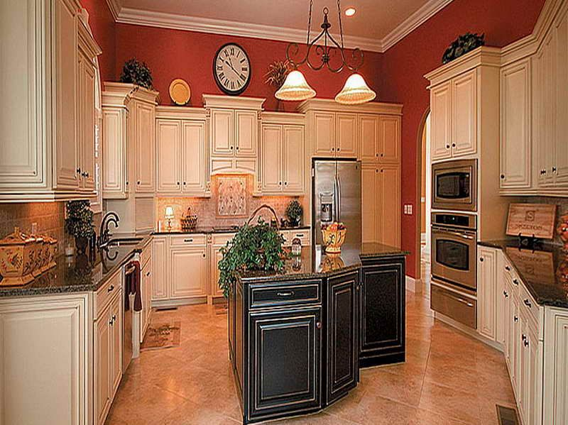 Pictures of antiqued kitchen cabinets with red wall for Grey kitchen cabinets with red walls