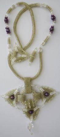 Beaded necklace with freshwater pearls and swarovski crystals designed and made by Ronel Durandt